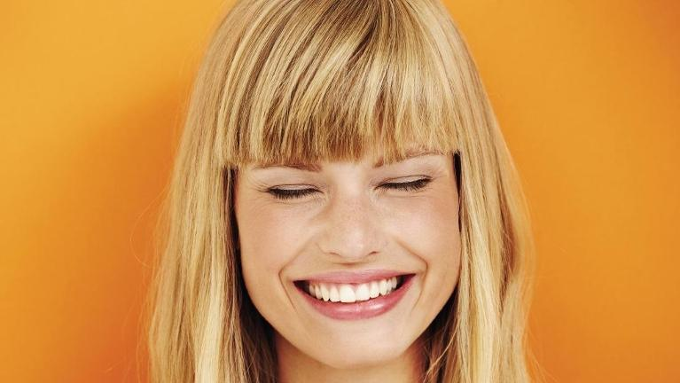 Woman smiling with her eyes closed | Dental Implants St Cloud FL