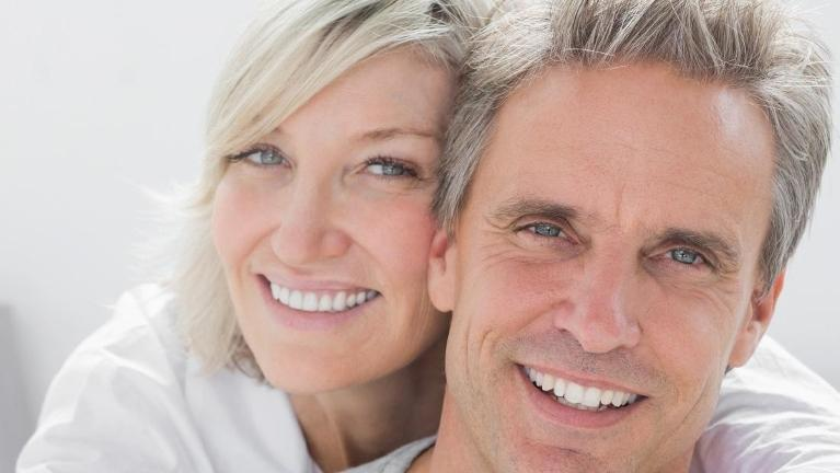 Woman hugging man from behind | Dental Implants St Cloud FL