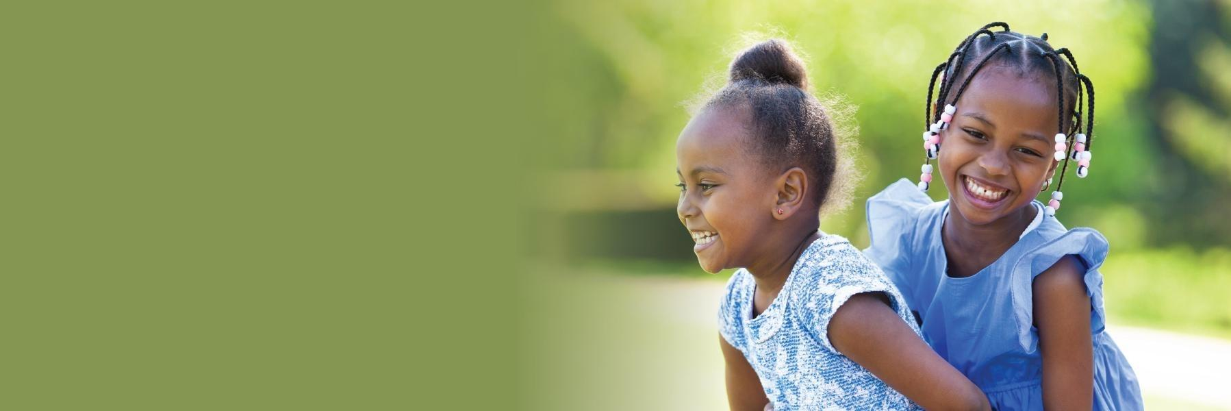 Two young girls playing outside | Pediatric Dentistry St. Cloud, FL